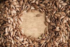 Healthy diet. Flax seeds linseed border on wooden background Royalty Free Stock Image