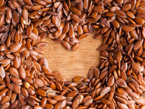 Healthy diet. Flax seeds linseed border on wooden background Stock Photography
