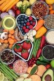 Healthy Diet Food. Concept of fruit, vegetables, herbs, spice, grains, nuts, seeds, olive oil and himalayan salt. Super foods high in antioxidants, fiber, smart stock image