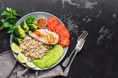 Healthy diet food quinoa, grilled chicken, avocado, broccoli, tomato. The concept of beneficial nutrition. Overhead,copy space