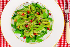 Healthy and diet food: Salad with arugula, avocado, kiwi, cucumb Royalty Free Stock Photo