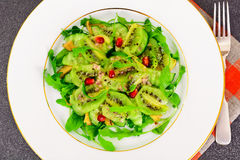 Healthy and diet food: Salad with arugula, avocado, kiwi, cucumb Royalty Free Stock Image
