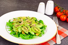 Healthy and diet food: Salad with arugula, avocado, kiwi, cucumb Royalty Free Stock Photography