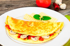Healthy and Diet Food: Scrambled Eggs with Mushrooms and Vegetab Stock Photography