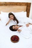 Healthy Diet Food For Woman's Health. Women Relaxing On Bed. Royalty Free Stock Photos