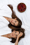 Healthy Diet Food For Woman's Health. Women Relaxing On Bed. Royalty Free Stock Photo