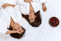Healthy Diet Food For Woman's Health. Women Relaxing On Bed. Stock Photography