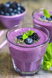 Healthy diet forest berry smoothie with chia seeds. Stock Photography