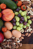 Healthy Diet with fresh fruit, eggs, nuts and vegetables. Stock Images