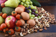 Healthy Diet with fresh fruit, eggs, nuts and vegetables. royalty free stock image