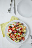 Healthy diet. Fresh fruit and vegetables salad Royalty Free Stock Image