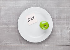 Healthy diet with fresh organic apple on the plate Stock Image