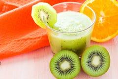 Healthy diet fruit juice kiwi orange wooden table Stock Images