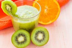 Healthy diet fruit juice kiwi orange wooden table Royalty Free Stock Photos