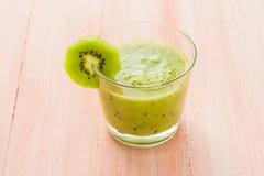 Healthy diet fruit juice kiwi wooden table Stock Photos