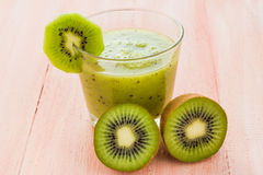 Healthy diet fruit juice kiwi wooden table Royalty Free Stock Image