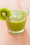 Healthy diet fruit juice kiwi wooden table Stock Photo
