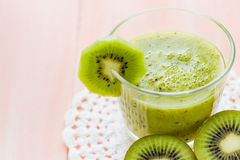 Healthy diet fruit juice kiwi wooden table Royalty Free Stock Photos