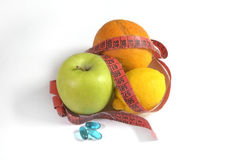 Healthy diet; fruit with measure Royalty Free Stock Photo