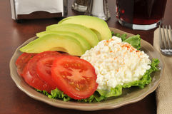 Healthy diet lunch. A healthy diet plate with cottage cheese, tomato and avocado Royalty Free Stock Photos