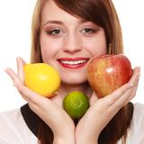 Healthy diet and nutrition. Girl holding fruits. Stock Images