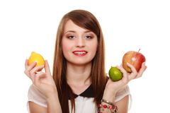 Healthy diet and nutrition. Girl holding fruits. Stock Photos