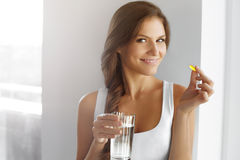 Healthy Diet. Nutrition. Vitamins. Healthy Eating, Lifestyle. Wo. Diet. Nutrition. Vitamins. Healthy Eating, Lifestyle. Close Up Of Happy Smiling Woman Taking Stock Image