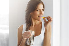 Free Healthy Diet. Nutrition. Vitamins. Healthy Eating, Lifestyle. Woman With Fish Oil Capsules. Royalty Free Stock Photo - 62191375