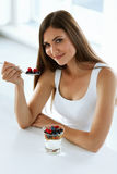 Healthy Diet Nutrition. Woman Eating Yogurt, Berries And Cereal. Healthy Diet Nutrition. Portrait Of Cheerful Girl Having Glass Of Natural Yogurt, Tasty Berries Stock Photo