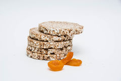 Healthy diet. Products for a healthy diet and good digestion, bread with dried apricots on white background Royalty Free Stock Image
