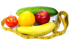 Healthy Diet. Red  apples, oranges, banana, cucumber and tomatoes and measuring tape. Healthy diet and weight loss concept Stock Images