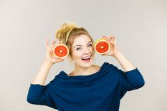 Happy smiling woman holding red grapefruit Royalty Free Stock Images