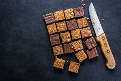 Healthy diet snack, oat flap jack brownie bar. View from overhead on dark slate Stock Images