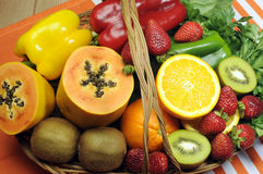 Healthy diet - sources of Vitamin C - fruit and vegetables in basket. Healthy diet - sources of Vitamin C - oranges, strawberry, bell pepper capsicum, kiwi Royalty Free Stock Photography