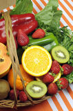 Healthy diet - sources of Vitamin C - vertical with copy space. Healthy diet - sources of Vitamin C - oranges, strawberry, bell pepper capsicum, kiwi fruit, paw Stock Photo