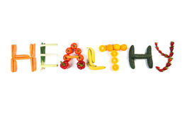 HEALTHY DIET text made out of fruits and vegetables isolated on white. Background Royalty Free Stock Photography