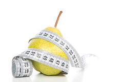 Healthy diet weight loss concept with pear and tape measure. On a white background Royalty Free Stock Photography