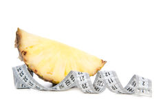 Healthy diet weight loss concept with slice of pineapple Royalty Free Stock Photos