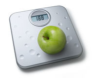 Healthy Diet Weight Scales Apple. A bathroom scale with an apple balanced  on it isolated on white Royalty Free Stock Photos