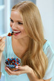 Healthy Diet. Woman Eating Cereal, Berries In Morning. Nutrition Stock Images