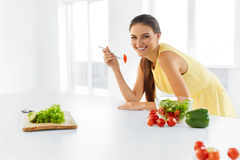 Healthy Diet. Woman Eating Vegetarian Salad. Healthy Eating, Foo. Healthy Diet. Beautiful Smiling Woman Eating Fresh Organic Vegetarian Salad In Modern Kitchen Royalty Free Stock Images