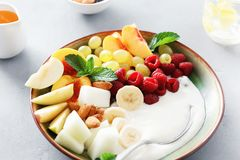 Healthy food table fruit breakfast natural yoghurt bowl. Healthy and dietary food concept, side view. Fruit breakfast and natural yoghurt bowl. Grapes, peach stock photo