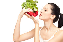Healthy dieting food - concept. Attractive woman eating a healthy dieting food, isolated on white Royalty Free Stock Photo