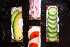 Healthy different rye sandwiches from whole grain rye crispbread. The concept of healthy eating stock image