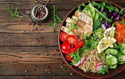Buddha bowl lunch with grilled chicken and quinoa, tomato, guacamole stock photo