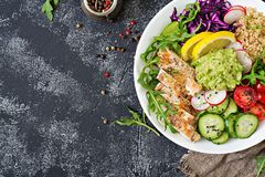 Buddha bowl lunch with grilled chicken and quinoa, tomato, guacamole,. Healthy dinner. Buddha bowl lunch with grilled chicken and quinoa, tomato, guacamole, red Stock Photo