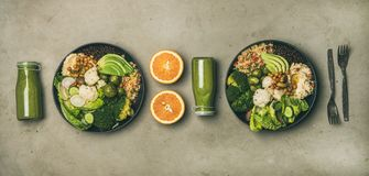 Healthy dinner with superbowls and green smoothies in bottles. Healthy dinner, lunch setting. Flat-lay of vegan superbowls or Buddha bowls with hummus, vegetable stock images