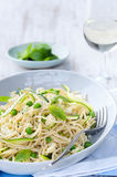 Healthy dinner pasta with fresh vegetables and herbs Royalty Free Stock Photos