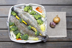 Healthy dinner: trouts and vegetables Stock Photos