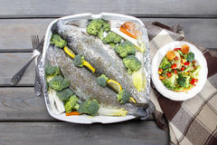 Healthy dinner: trouts and vegetables Royalty Free Stock Photos